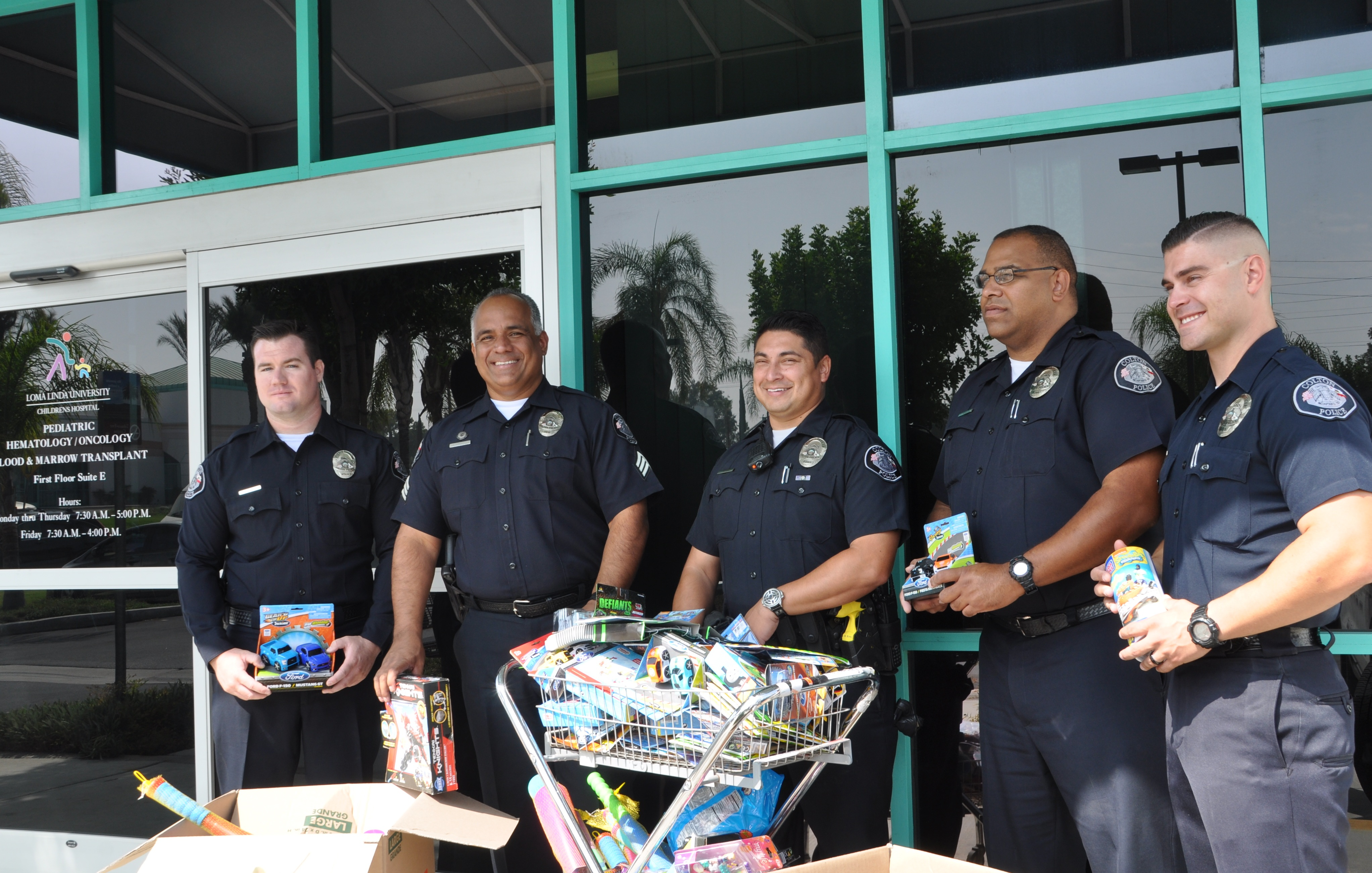 Colton Police helps D.A.R.E. distribute toys to patients at Hematology/Oncology Outpatient Clinic
