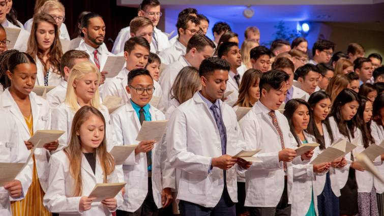 first-year medical students stand on the church steps to recite oath