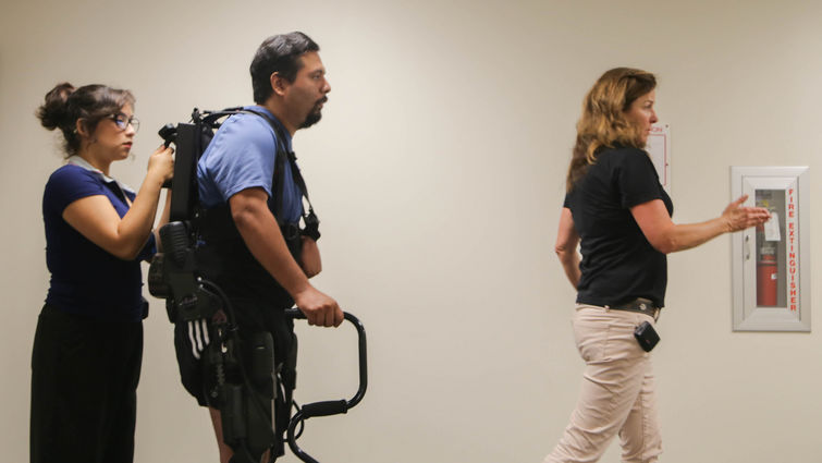 Male learning to walk with the Ekso