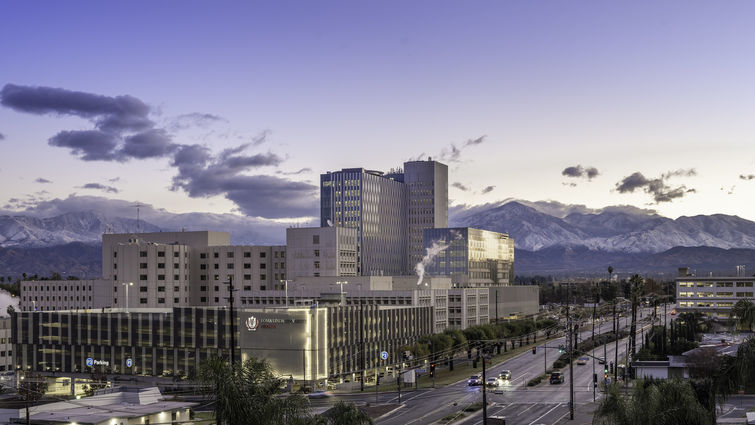 scenic photo of medical campus with mountains in background