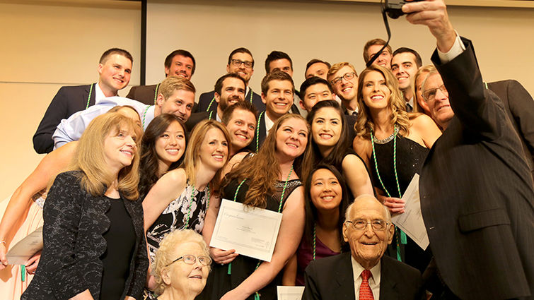 Newly inducted members of the Alpha Omega Alpha honor medical society gather for a group photo