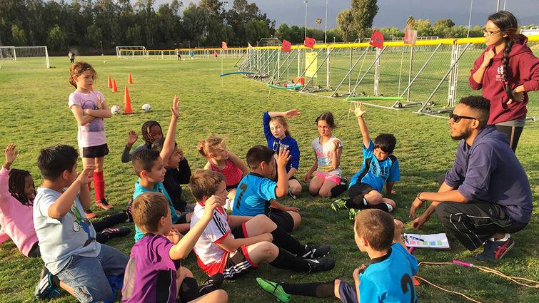 Brenda Spoelstra of the Loma Linda University Institute for Community Partnerships coaches soccer for children