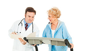 Patient on treadmill with doctor