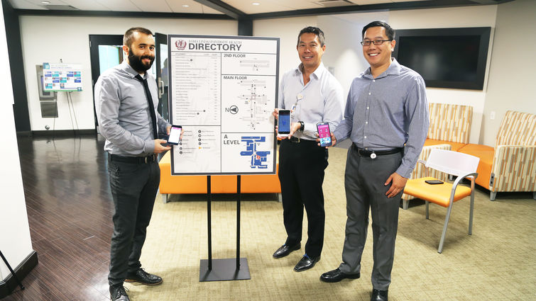 Members of the Wayfinding Committee at Loma Linda University Health display the mobile app