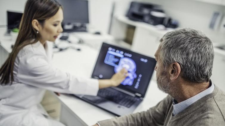 doctor shows patient brain scan