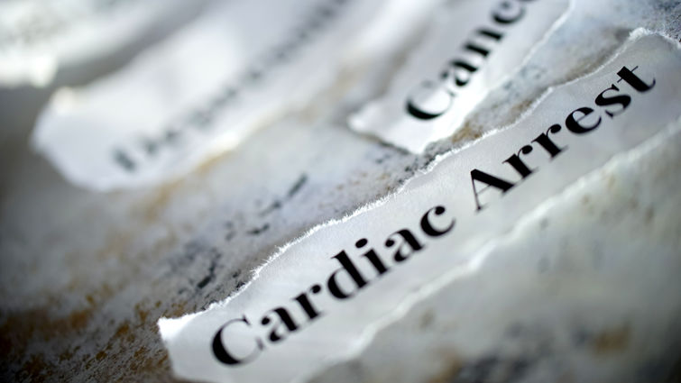 Pieces of paper on the table that say cardiac arrest and cancer