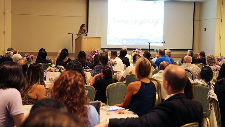 Judy Chatigny, MSN, addresses event attendees