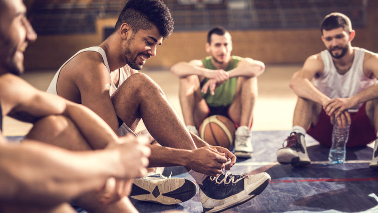 Young men taking a break from basketball