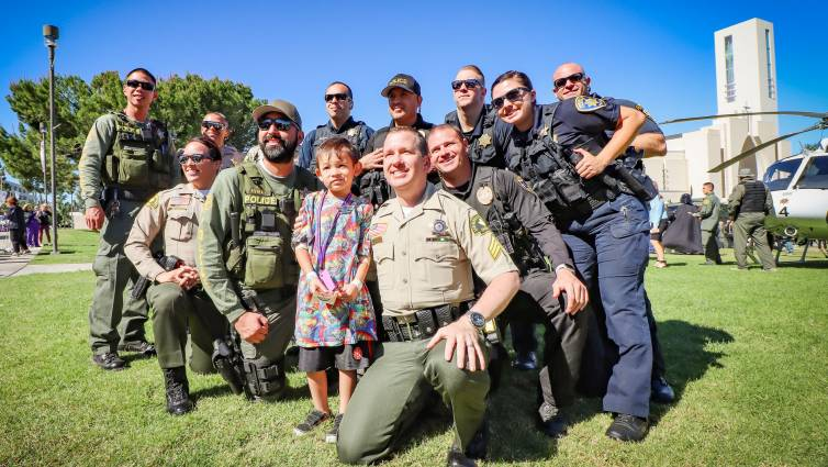 Loma Linda University Children's Hospital patient, Rocky Zepeda, 6, of Victorville, with his new friends and role models at the 20th annual Cops for Kids Fly-In on Tuesday, Oct 16.