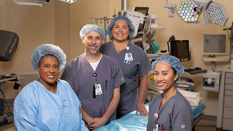 four nurse employees pose for photo