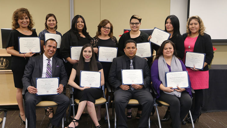 Group photo of recent graduates of San Manuel Gateway College holding diplomas