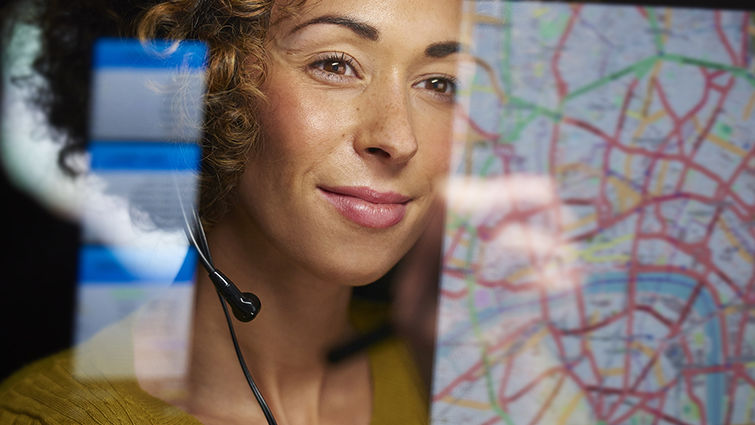 A woman looks happy while viewing an online map