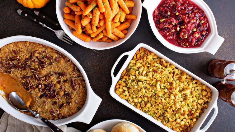 Platters of thanksgiving food on a table