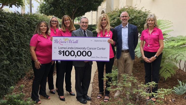 Stater Bros. Charities and Inland Women Fighting Cancer present a $100,000 check to LLU Cancer Center