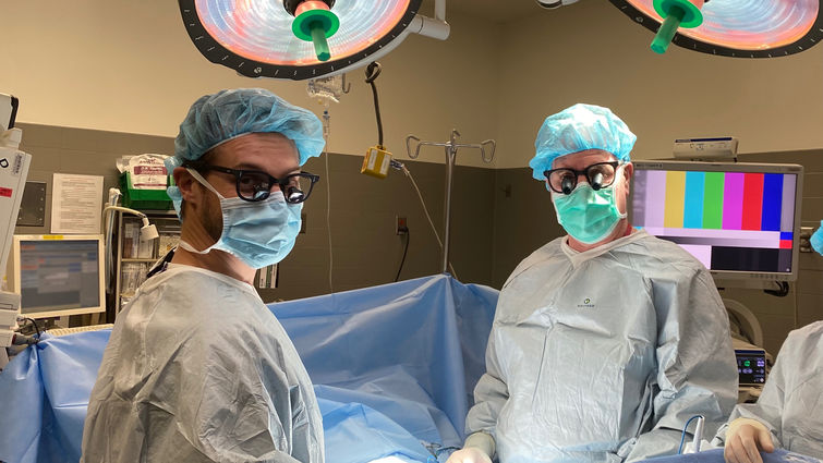 two male doctors in operating room