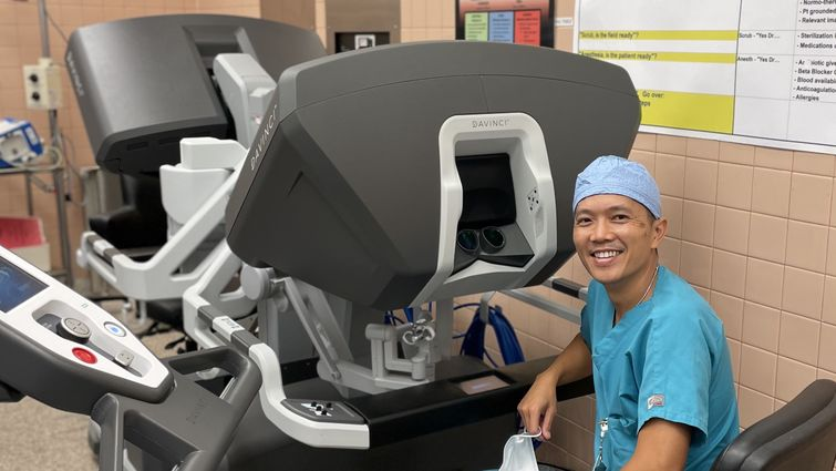Dr. Le sits at the surgical robot's console, where he performs minimally invasive chest surgeries on patients