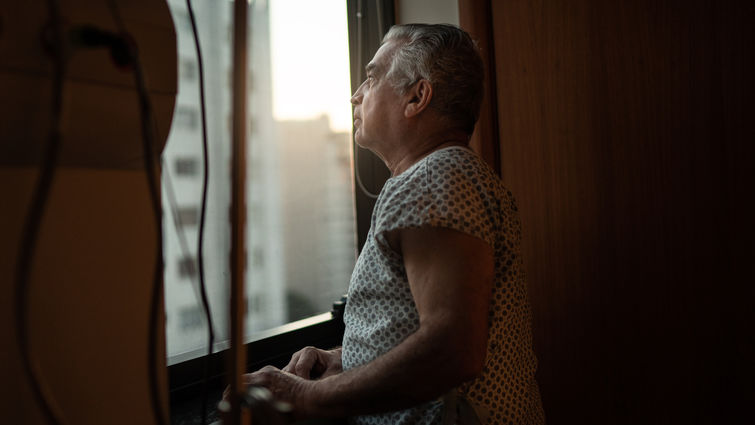 Senior patient looking out hospital window