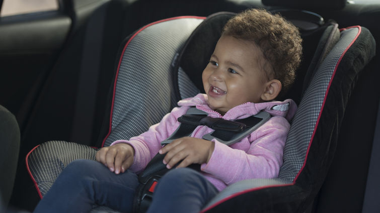 baby in car seat in car