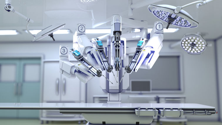 surgical robot in operating room above operating table