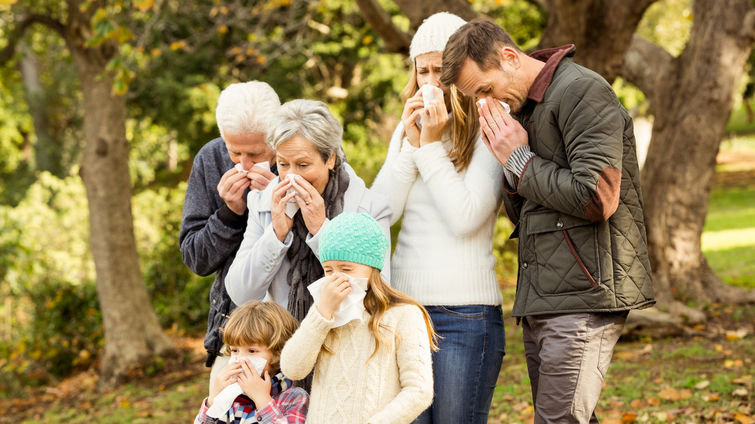 Sick family blowing their noses