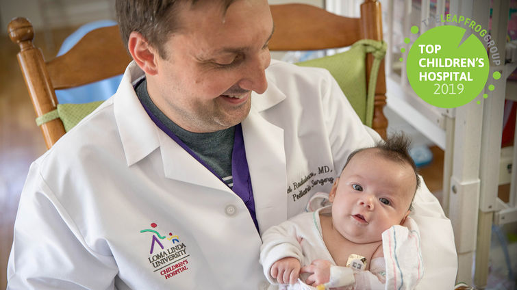 physician holds infant patient