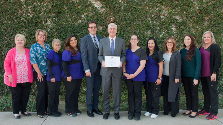 Group photo of physicians and staff at the LLU Department of Family Medicine with award
