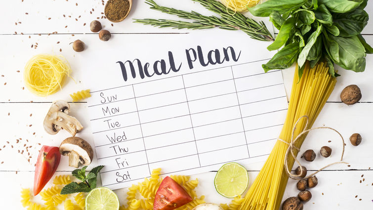 Pasta, vegetables, fruits and meal plan text.