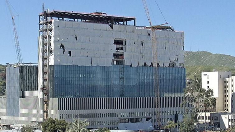 Tarps cover building framework