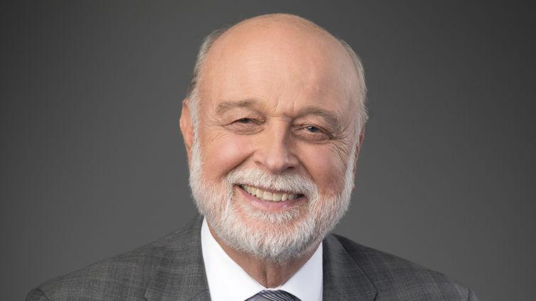 Man smiles in formal portrait