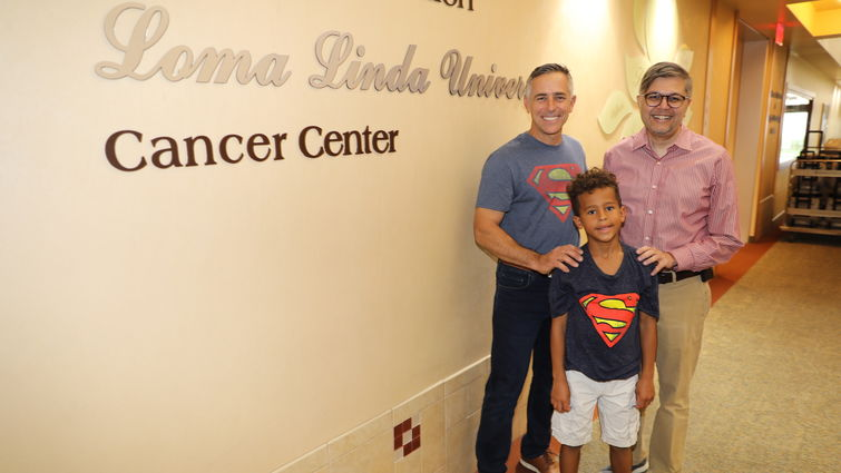 cancer survivor, student and doctor stand together