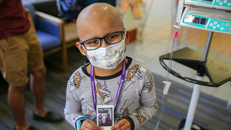 LLUCH patient, Edgar Rodriguez, 6, from San Jacinto, showing a photo of him and the Princess Spirit team.