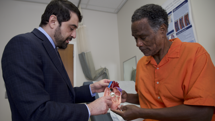 Doctor and patient examine heart