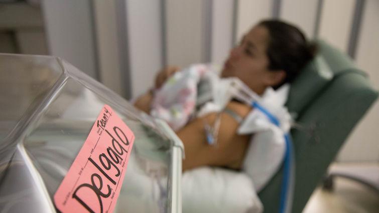 New mom Leticia Delgado holds her tiny baby, Emmarose Delgado, in the NICU at Loma Linda University Children's Hospital.