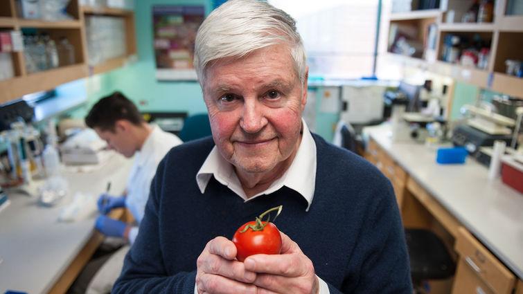 William Langridge, PhD, holding a tomato