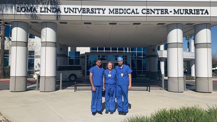three surgeons standing