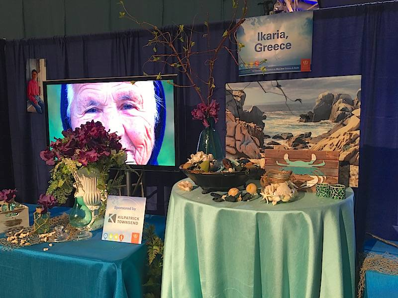 A booth representing Ikaria, Greece, one of the five Blue Zones, at the Healthy People Conference.