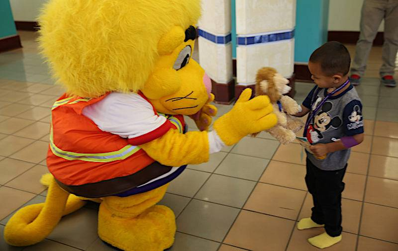 LLUCH patient and Luke the Lion.