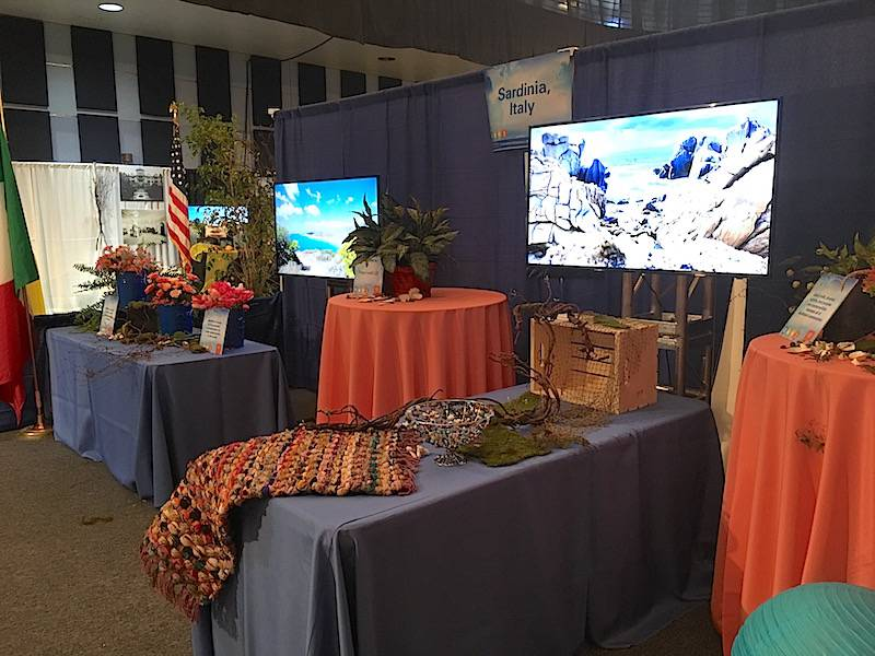 A booth representing Sardinia, Italy, one of the five Blue Zones, at the Healthy People Conference.
