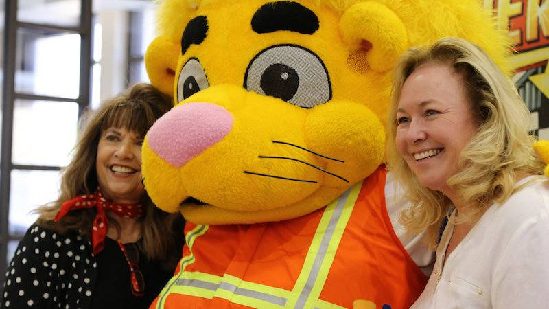 Carol Troesh (left) and Rachelle Bussell took a photo opp with Luke the Lion.