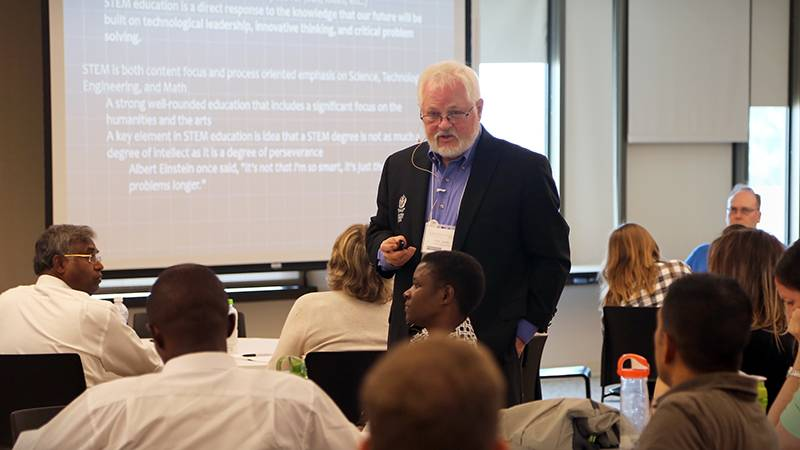 """Ronald Carter, PhD, provost, welcomes attendees to EXSEED, which has conceptually expanded from enhancing STEM (science, technology, engineering and math) education to include """"A"""" for the arts (humanities), """"R"""" for religion or spirituality and """"S"""" for service (STREAMS)."""