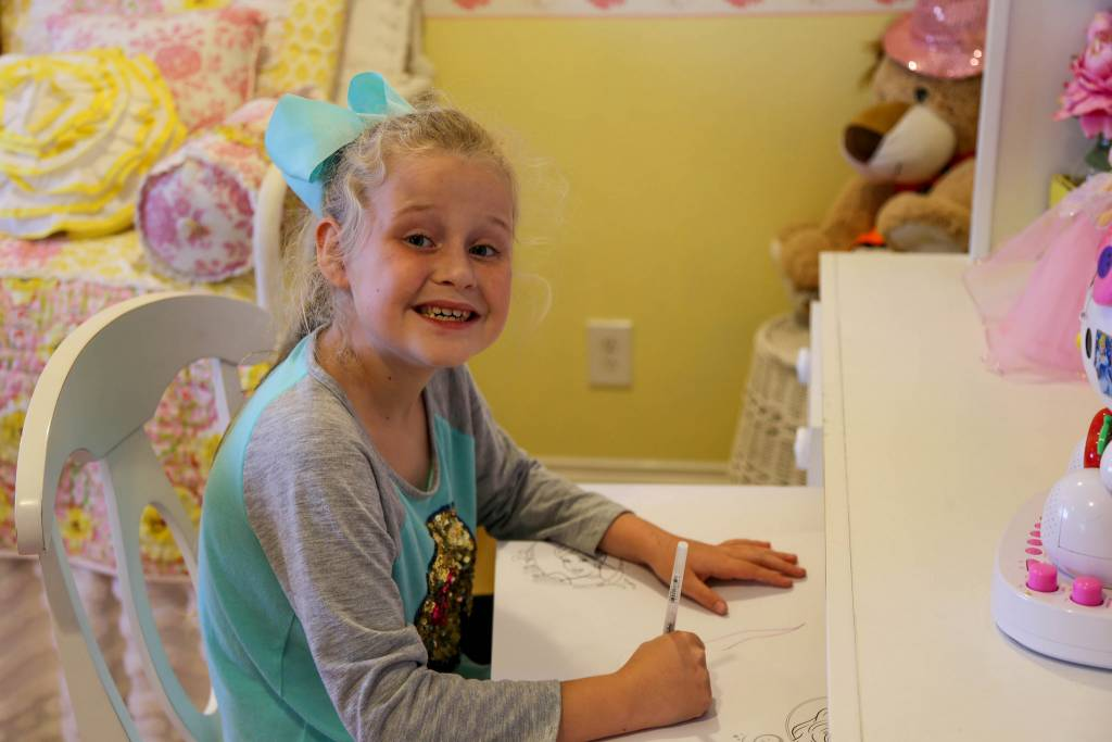 Sophia enjoys coloring, drawing and spending time with her new family.
