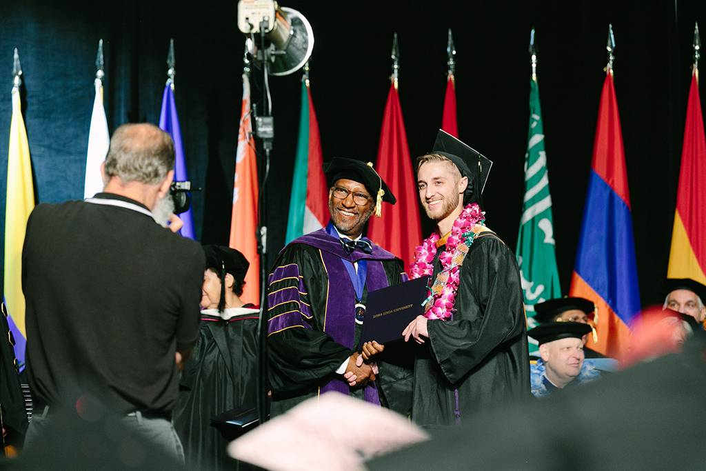 Craig Jackson, JD, MSW, acknowledged every student as they received their diploma.