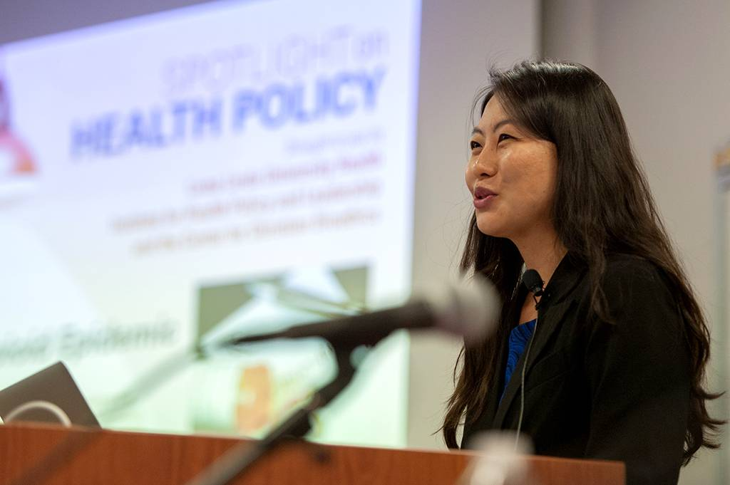 Wonha Kim, MD, MPH, CPH, FAAP, director of the Institute for Health Policy and Leadership, welcomes guests to the presentation.