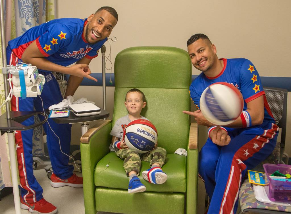 """Zeus"" McClurkin, left, and ""El Gato"" Melendez spent time with children and their families who are receiving care at the hospital. The Harlem Globetrotters brought Valentine's Day cheer to children at the Loma Linda University Children's Hospital Hematology/Oncology Clinic on Wednesday, February 14, 2018, in Loma Linda, California."