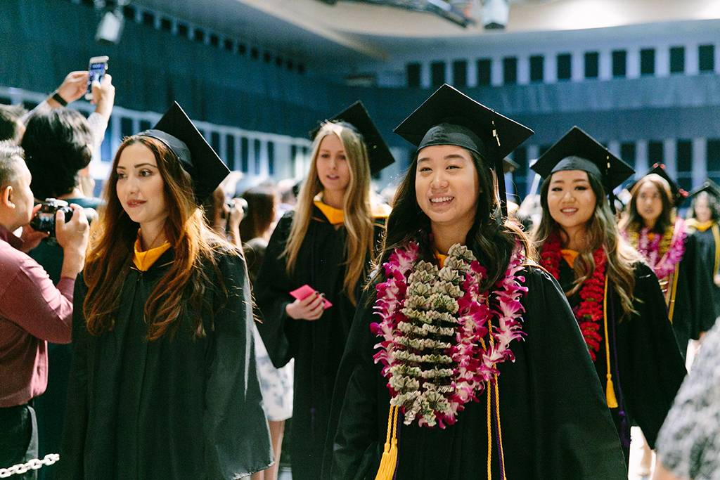 Students marched in for the first of two School of Allied Health Professions commencement services.