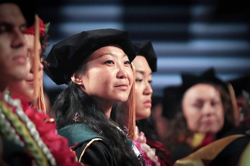 Joyful expectation illumines the face of a graduate.