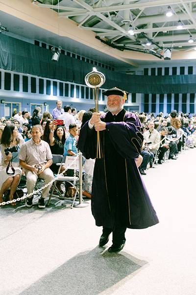 Provost Ronald L. Carter, PhD, led the procession into the auditorium carrying the traditional mace.