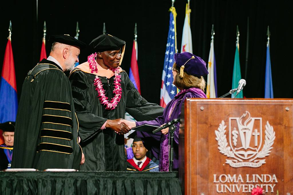 President Hart and Dean Marshak congratulate the recipient of one of three Dean's Awards.