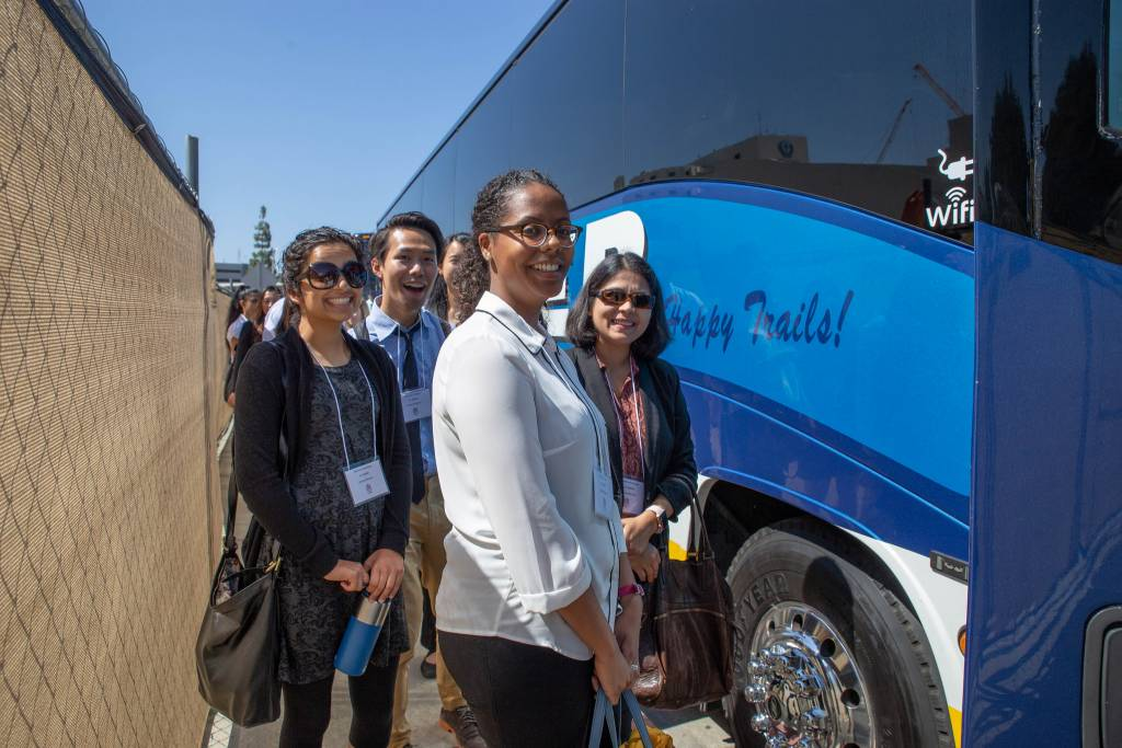 Resident physicians boarding a charter bus