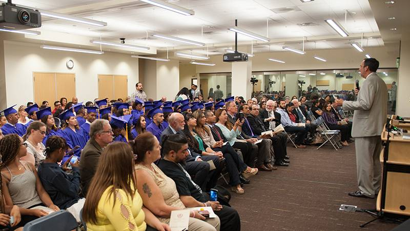 Executive Director Arwyn Wild, MA, addresses the room during the first commencement ceremony for San Manuel Gateway College in San Bernardino.
